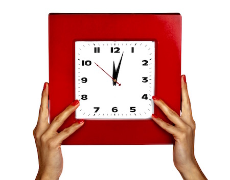 Woman holding up clock